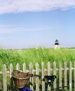 Bicycle in front of and Brant Point Light