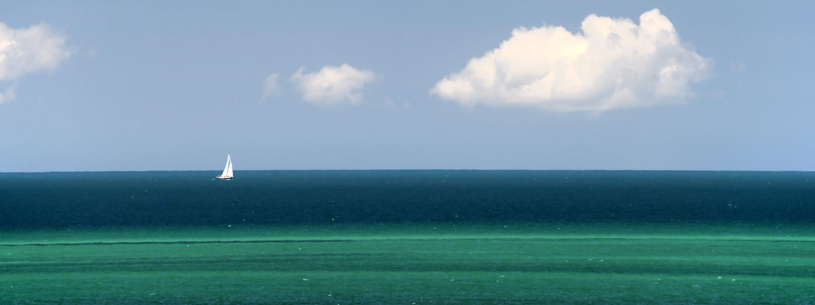 Sail boat on a calm ocean.